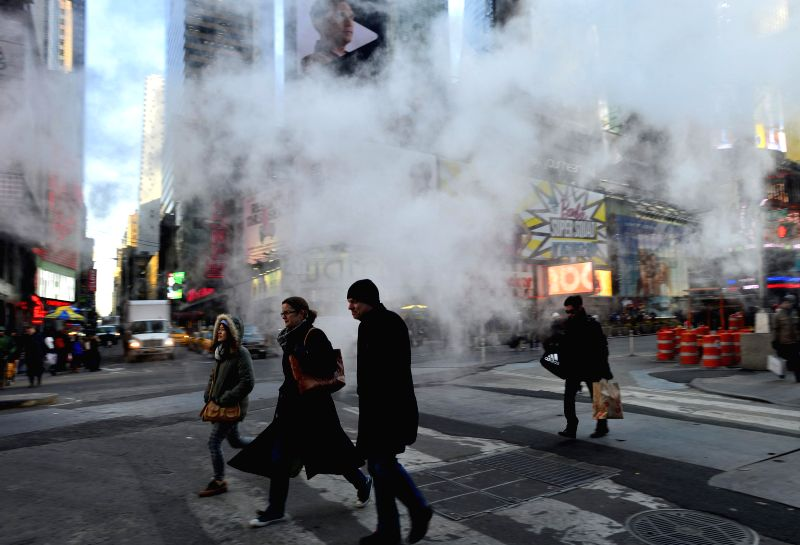 People walk in low temperatures at Times Square in New York City, the United States, on Feb. 20, 2015. New York City Emergency Management has issued a weather ...