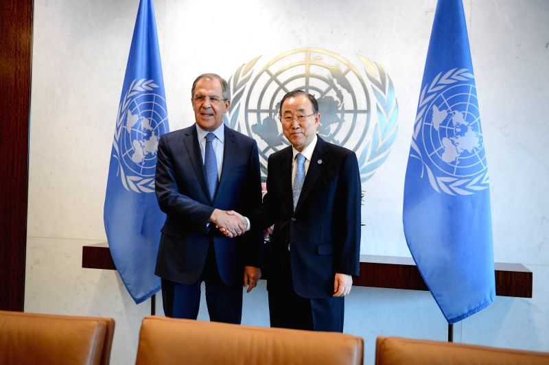 Russian Foreign Minister Sergey Lavrov (L) shakes hands with UN Secretary-General Ban Ki-moon during their meeting at the UN headquarters in New York on Feb. 23, ... - Sergey Lavrov