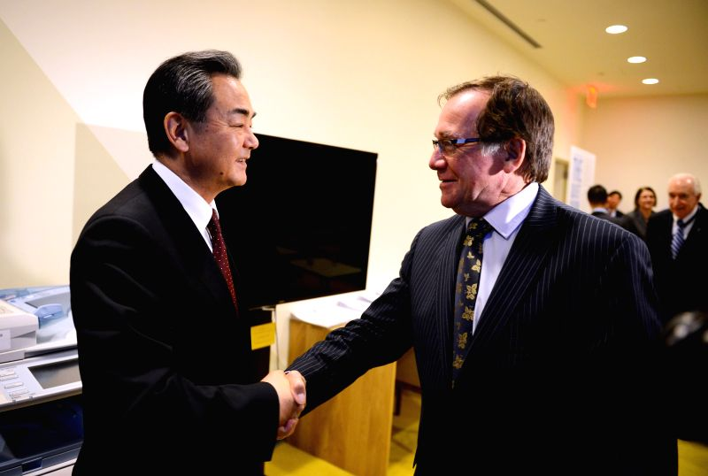 Chinese Foreign Minister Wang Yi (L) meets with his New Zealand counterpart Murray McCully at the UN headquarters in New York, the United States, on Feb. 23, 2015. ... - Wang Y