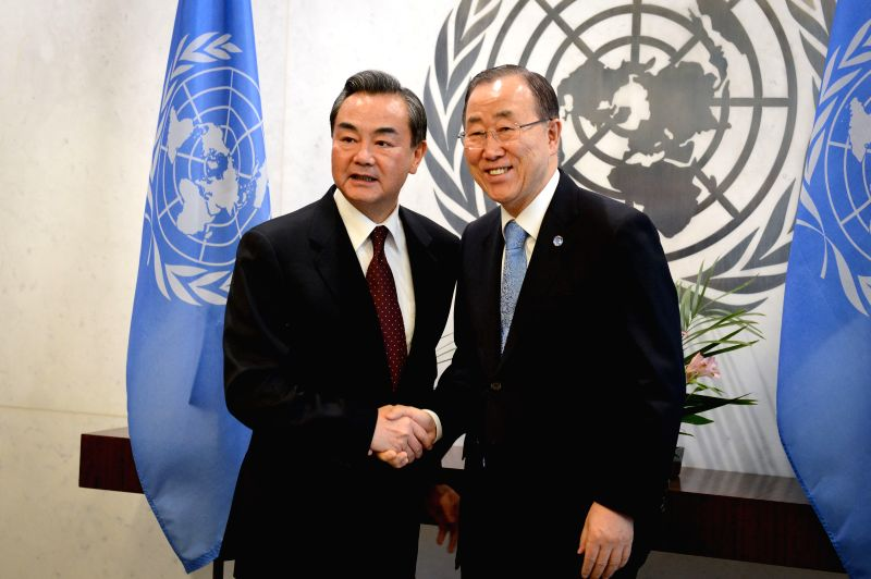 Chinese Foreign Minister Wang Yi (L) meets with United Nations Secretary-General Ban Ki-moon in New York, the United States, on Feb. 23, 2015. (Xinhua/Niu ... - Wang Y