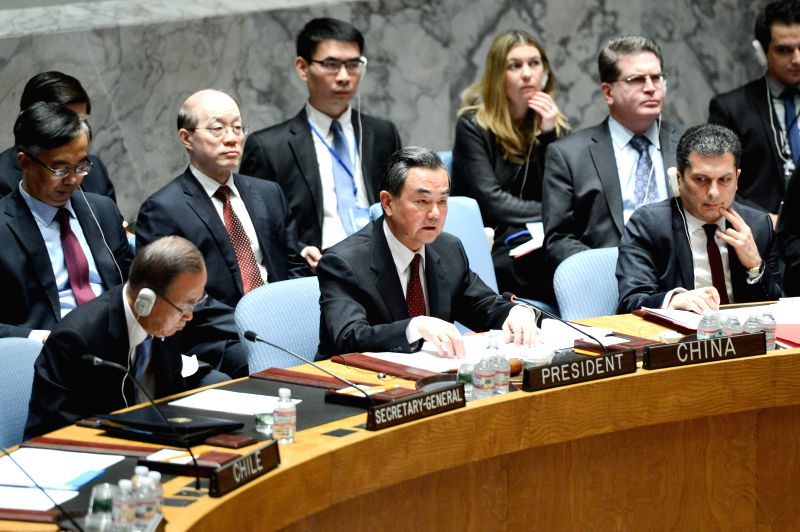 Wang Yi (C), Chinese foreign minister and president of the United Nations Security Council for February, presides over a UN Security Council open debate on ...