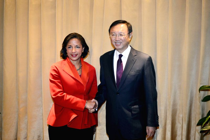 Chinese State Councilor Yang Jiechi (R) meets with U.S. National Security Adviser Susan Rice in New York, the United States, Feb. 25, 2015.  ...
