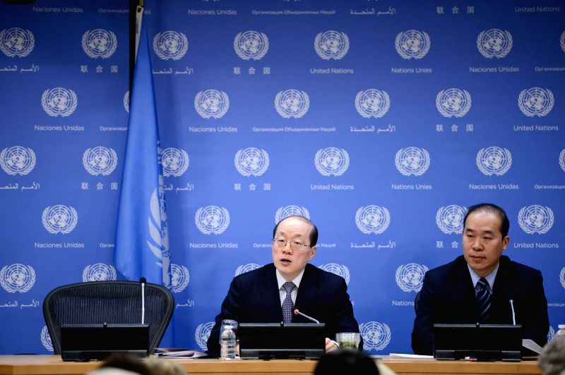 Liu Jieyi(L), China's permanent representative to the United Nations and rotating presidency of the Security Council for the month of February, speaks during a ... - Wang Y
