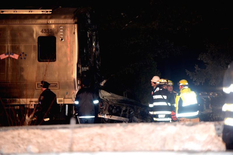Photo taken on Feb. 3, 2015 shows the scene where a commuter train collided with a car, in New York State, the United States. At least six people were killed and 12