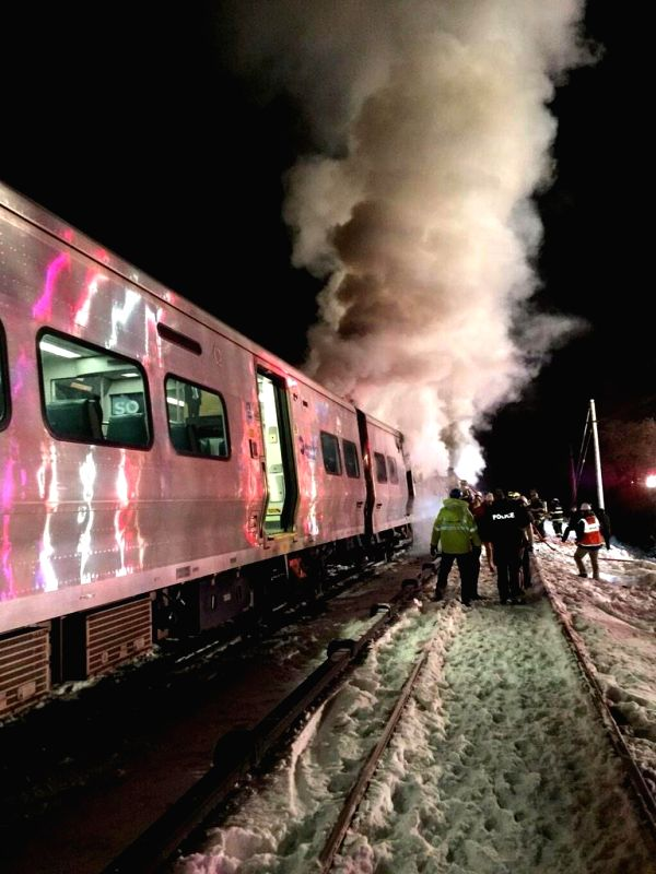 Photo taken with a cell phone on Feb. 3, 2015 shows the scene where a subway train collided with a bus, causing injuries, in New York State, the United States. ...