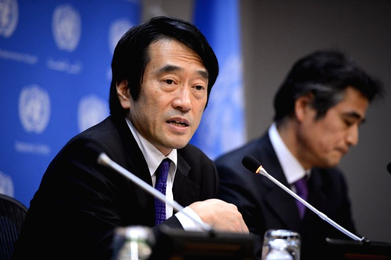 Yasuhisa Kawamura (L), press secretary of Japan's Ministry of Foreign Affairs, speaks during a press conference at the UN headquarters in New York, on Feb. 5, 2015.