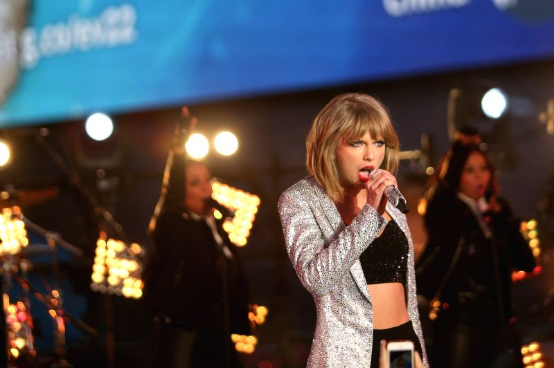 Singer Taylor Swift performs during the New Year's Eve celebration at Times Square in New York, the United States on Dec. 31, 2014.  Times Square has been the ...