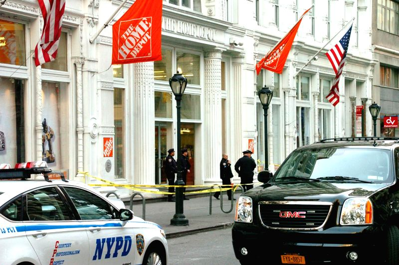 Police cordon off the site of a shooting inside a Mahhattan Home Deport store in New York City, the United States, Jan. 25, 2015. Two people were killed Sunday ...