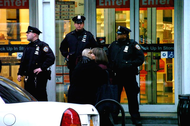 Police stand guard on the site of a shooting inside a Mahhattan Home Deport store in New York City, the United States, Jan. 25, 2015. Two people were killed Sunday