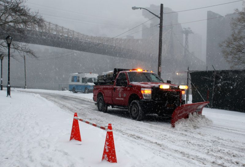 A snow sweeper works in a street on Roosevelt Island in New York, the United States, Jan. 26, 2015. New York State Governor Andrew Cuomo declared here Monday a ...