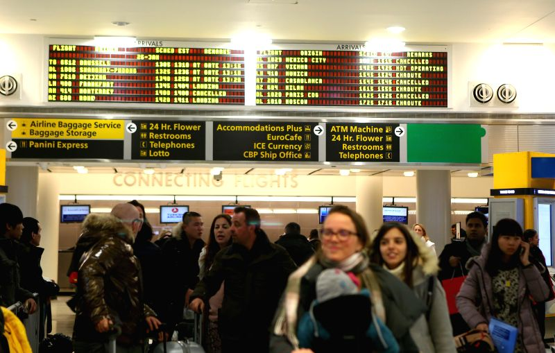 Passengers arrive at the JFK International Airport in New York, the United States, Jan. 26, 2015. New York State Governor Andrew Cuomo declared here Monday a state