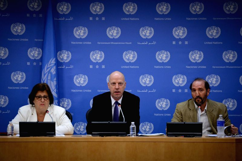John Wilmoth (C), director of the Population Division of the United Nations Department of Economic and Social Affairs, briefs the press on the 2014 revision of the