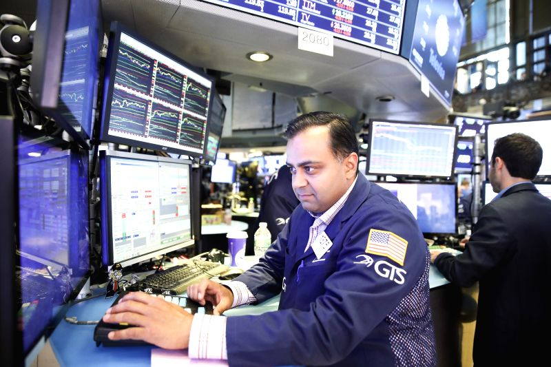 NEW YORK, July 13, 2018 - Traders work at the New York Stock Exchange in New York, the United States, on July 13, 2018. U.S. stocks closed higher on Friday. The Dow Jones Industrial Average rose ...