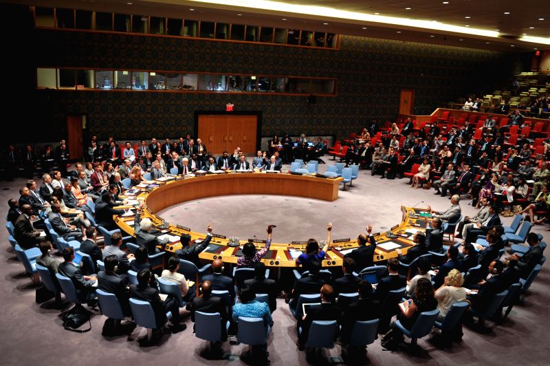 Members of the United Nations Security Council vote unanimously for a draft resolution regarding Syria, at the UN headquarters in New York, on July 14, 2014. The ..
