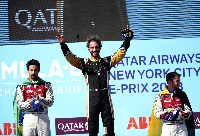 NEW YORK, July 17, 2018 - Jean-Eric Vergne (C) of France from the Chinese-based team Techeetah celebrates victory after winning the final race of all-electric Formula E season in New York, the United ...