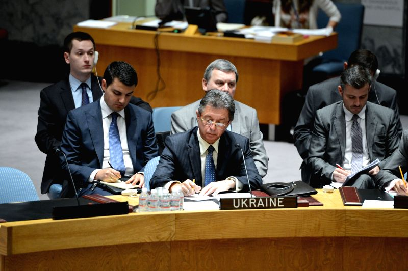 Ukrainian ambassador to the United Nations Yuriy Sergeyev (C, front) takes notes during an emergency meeting of the UN Security Council on the situation in ...