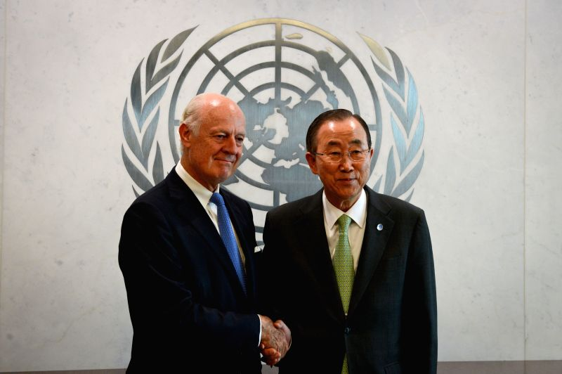 United Nations Secretary-General Ban Ki-moon (R) shakes hands with his Special Envoy for Syria Staffan de Mistura, prior to their meeting at the UN headquarters in