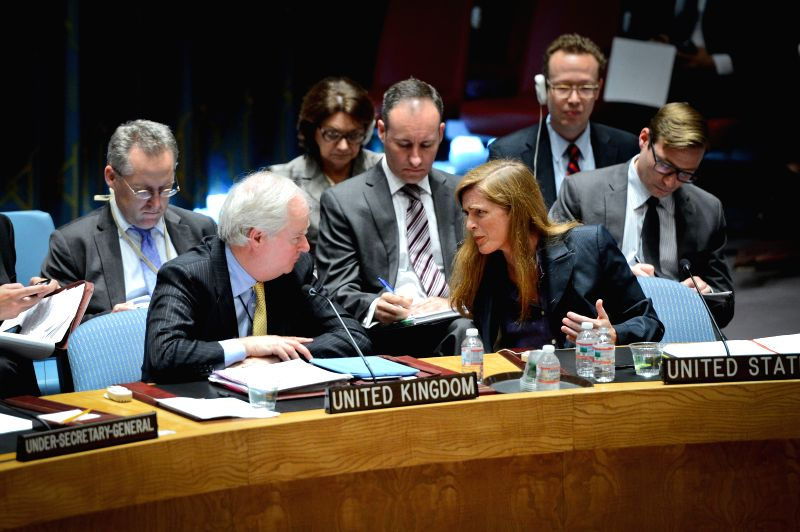 US ambassador to the United Nations Samantha Power (R, front) talks with her British counterpart Mark Lyall Grant during an emergency meeting of the UN Security ...