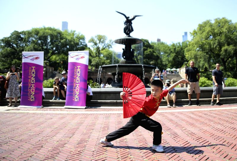 NEW YORK, July 18, 2018 - A boy performs martial arts during a traditional dragon boat awakening ceremony for the 28th annual Hong Kong Dragon Boat Festival in New York, the United States, on July ...