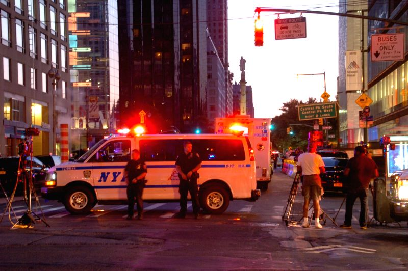NEW YORK, July 21, 2016 - Police officers stand guard near the Columbus Circle in Manhattan, New York, the United States, July 21, 2016. A man tossed a hoax explosive into a marked police car in ...