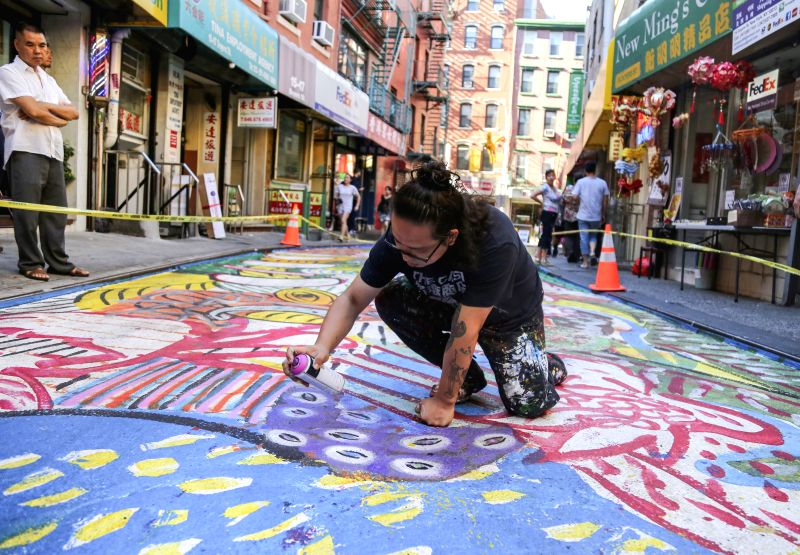 NEW YORK, July 21, 2018 - Chen Dongfan makes last embellishment of his work in Doyers Street in Manhattan's Chinatown, New York City, July 20, 2018. Doyers Street, a 200-foot-long (61-meter) street ... - Chen Dongfan