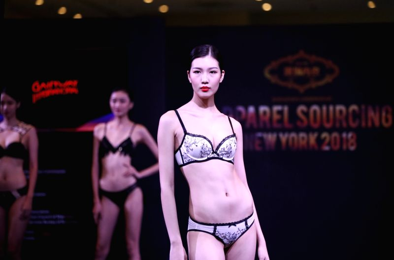 NEW YORK, July 24, 2018 - A model presents an underwear creation during a show at the Chinese Textile and Apparel Trade Show in New York, the United States, July 23, 2018. The 19th China Textile and ...