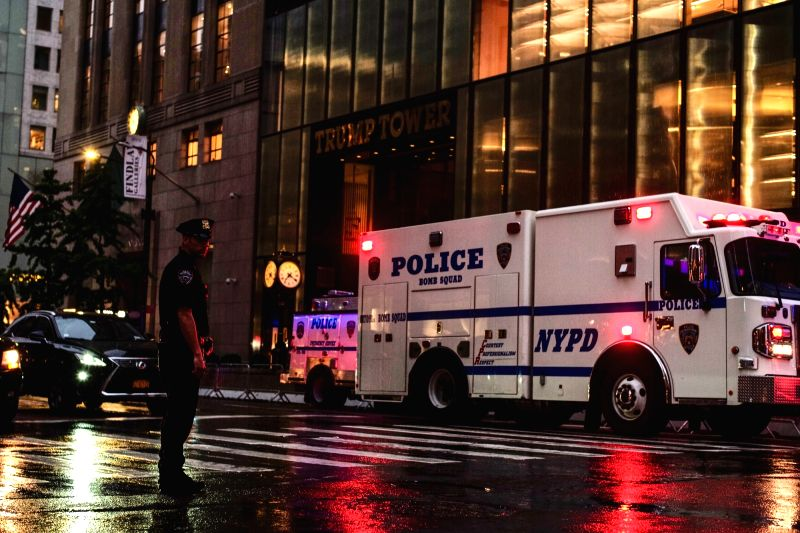 NEW YORK, July 27, 2018 - A police officer stands guard outside the Trump Tower in New York, the United States, July 27, 2018. Several suspicious packages found at the Trump Tower in Manhattan were ...