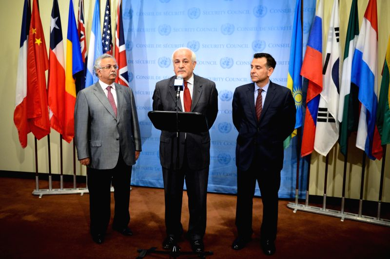 Palestinian ambassador to the UN Riyad H. Mansour (C) speaks to media reporters as his Saudi Arabian (L) and Jordanian counterparts look on after an emergency ...