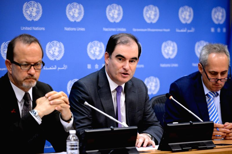 John Ging (C), operations director for the UN Office for the Coordination of Humanitarian Affairs (OCHA), speaks during a press briefing at the United Nations ...