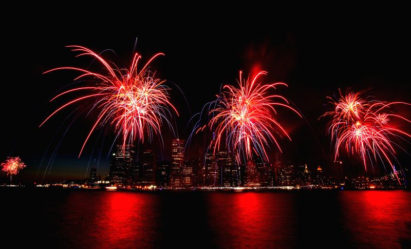 Fireworks explode over the East Rive in New York, the United States on July 4, 2014. The United States celebrated its 238th Independence Day on Friday. ...