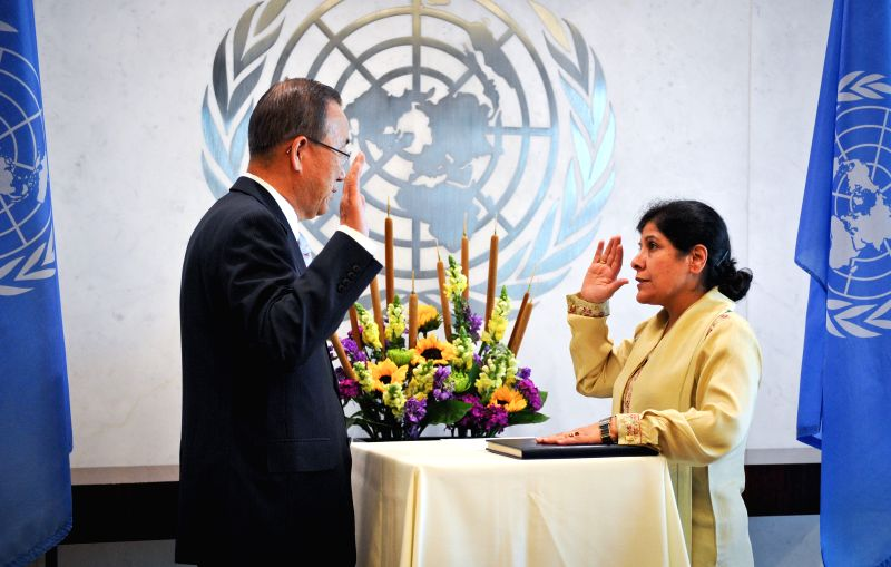 Shamshad Akhtar (R), Executive Secretary of the UN Economic and Social Commission for Asia and the Pacific, takes an oath in front of UN Secretary-General Ban ...