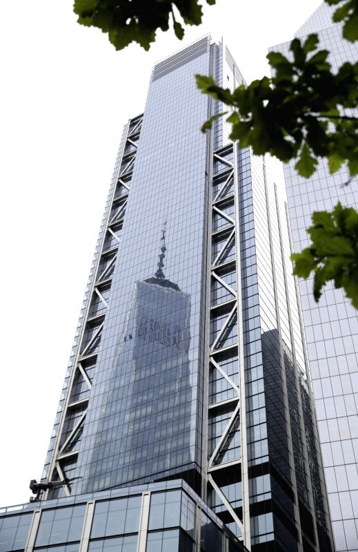 NEW YORK, June 11, 2018 - The image of One World Trade Center is reflected on the exterior surface of 3 World Trade Center in lower Manhattan, New York, the United States, on June 11, 2018. The ...