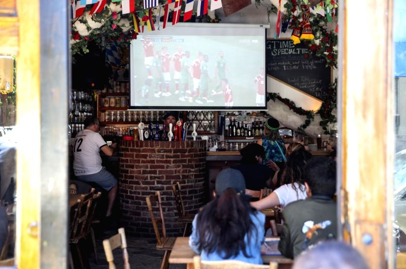 NEW YORK, June 14, 2018 - People watch live broadcast of World Cup match at a Soccer-themed bar in lower Manhattan of New York, the United States, June 14, 2018. As the 2018 FIFA World Cup kicked off ...