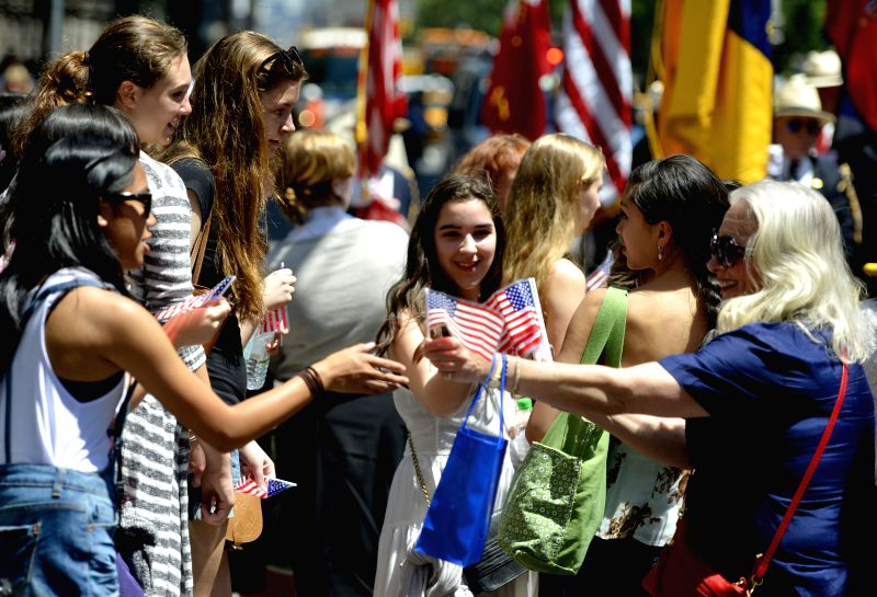People attend the Flag Day parade in Manhattan, New York City, the United States, on June 16, 2014. The Flag Day is celebrated every year to commemorate the ...