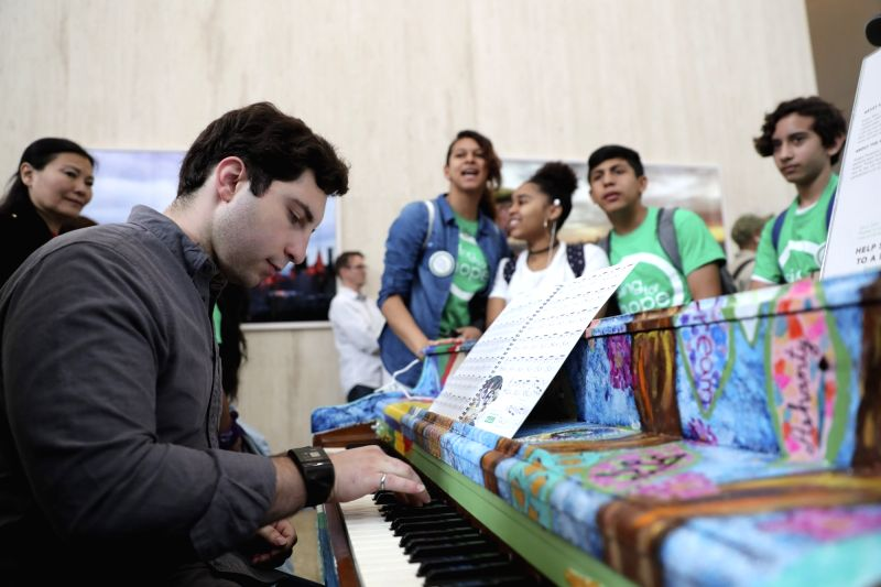 NEW YORK, June 5, 2017 - Piano hobbyist Joe Borrello plays the piano, as the students from Claremont International High School who decorated the piano look on, during the opening event of Sing for ...
