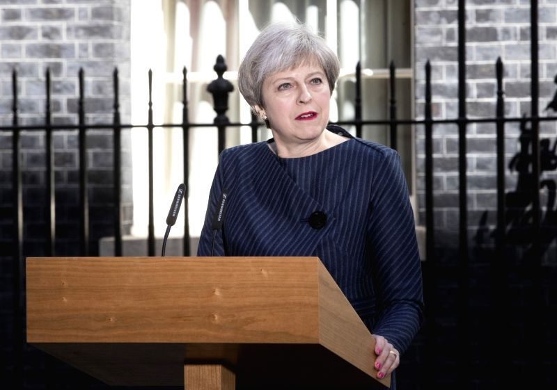NEW YORK, June 8, 2017 - File photo taken on April 18, 2017 shows British Prime Minister Theresa May speaking to media outside 10 Downing Street as she calls a snap general election in London, ... - Theresa May