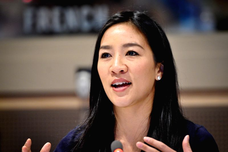 """Olympic figure skater Michelle Kwan speaks during an event titled """"the Place of Sport for Women's Empowerment Post-2015"""", at the UN headquarters in New ..."""
