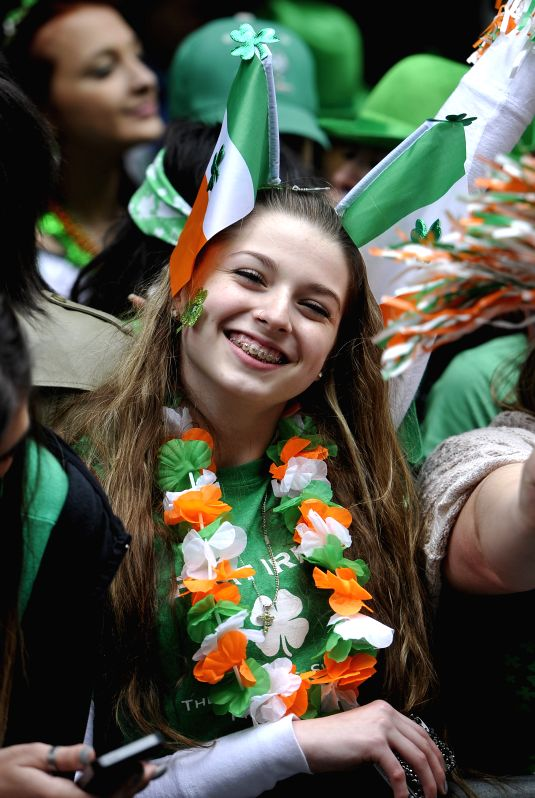 A woman with green headgear celebrates during the St. Patrick's Day Parade in New York, the United States, March 17, 2015.