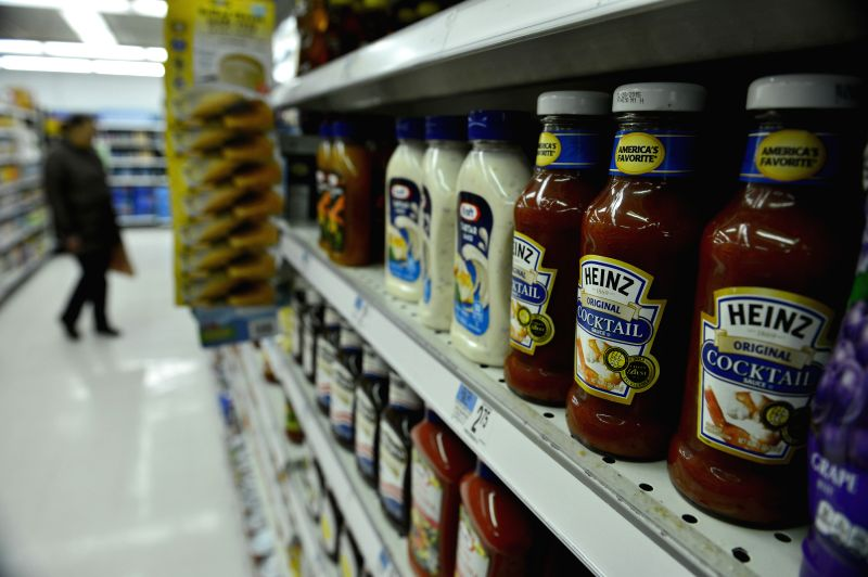 Photo taken on March 25, 2015 shows products of H.J. Heinz Company and Kraft Foods Group at a supermarket in New York, the United States. Ketchup maker H.J. Heinz ...