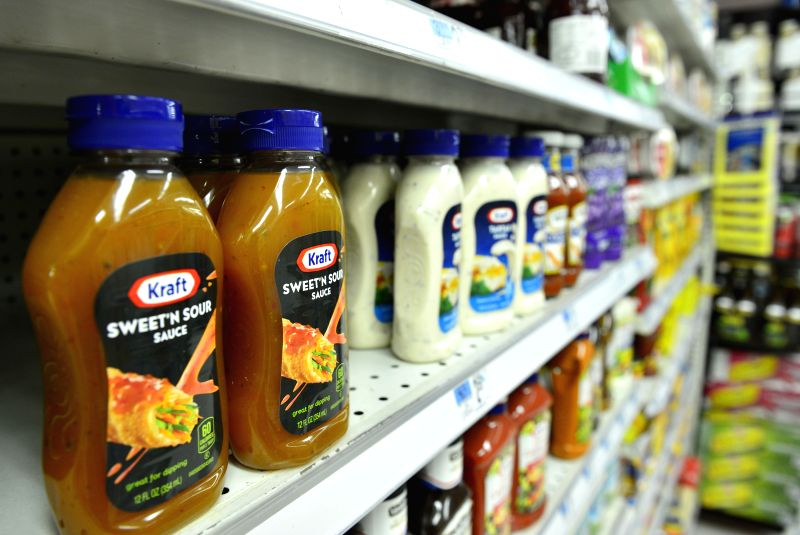 Photo taken on March 25, 2015 shows products of Kraft Foods Group at a supermarket in New York, the United States. Ketchup maker H.J. Heinz Company and Kraft ...