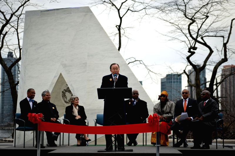 "UN Secretary-General Ban Ki-moon (C) speaks during the unveiling ceremony of a permanent memorial named ""Ark of Return"" to honour the victims of slavery ..."