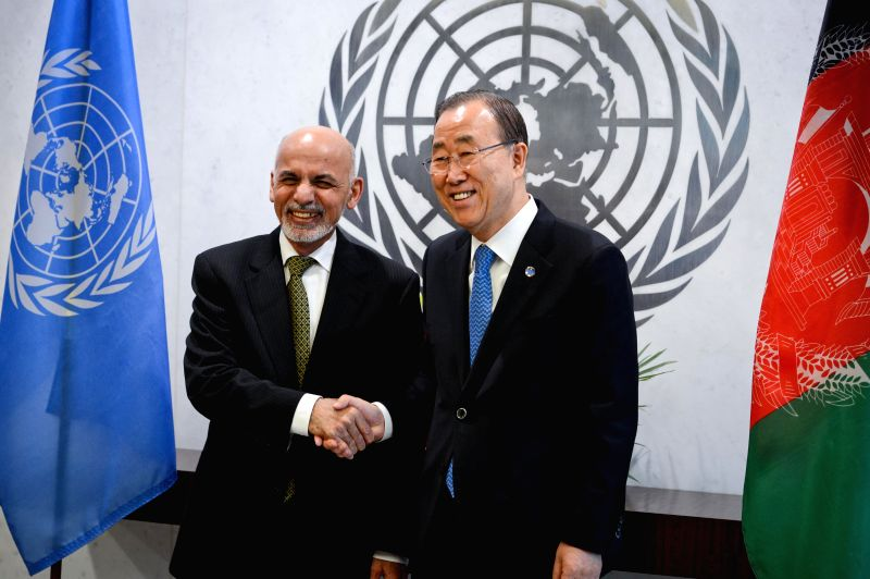 Afghan President Ashraf Ghani (L) poses for pictures with UN Secretary-General Ban Ki-moon during their meeting at the UN headquarters in New York, on March 26, ...