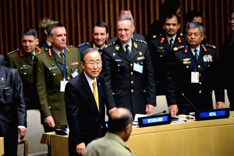 UN Secretary-General Ban Ki-moon (front L) leaves after addressing the first-ever UN Chiefs of Defense Conference at the UN headquarters in New York on March 27, ...
