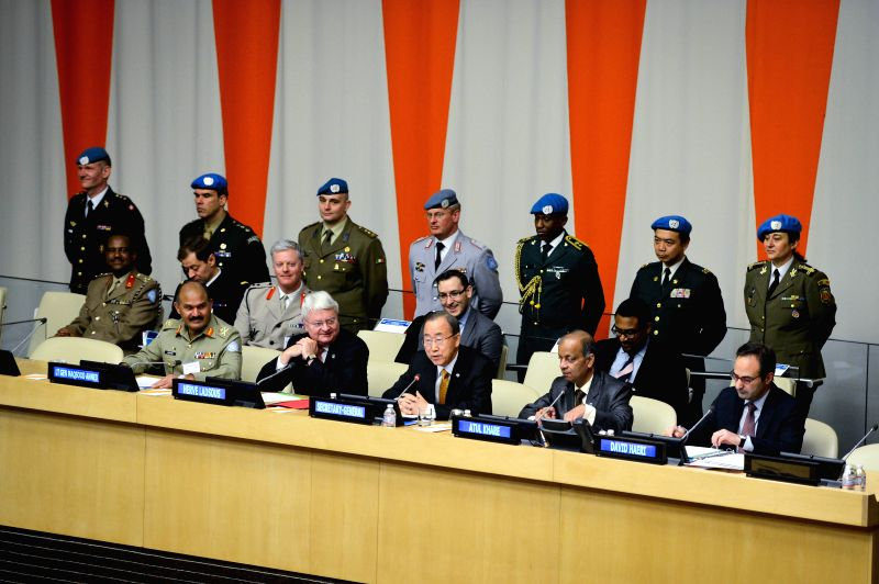UN Secretary-General Ban Ki-moon (C) addresses the first-ever UN Chiefs of Defense Conference at the UN headquarters in New York on March 27, 2015. The first-ever ...