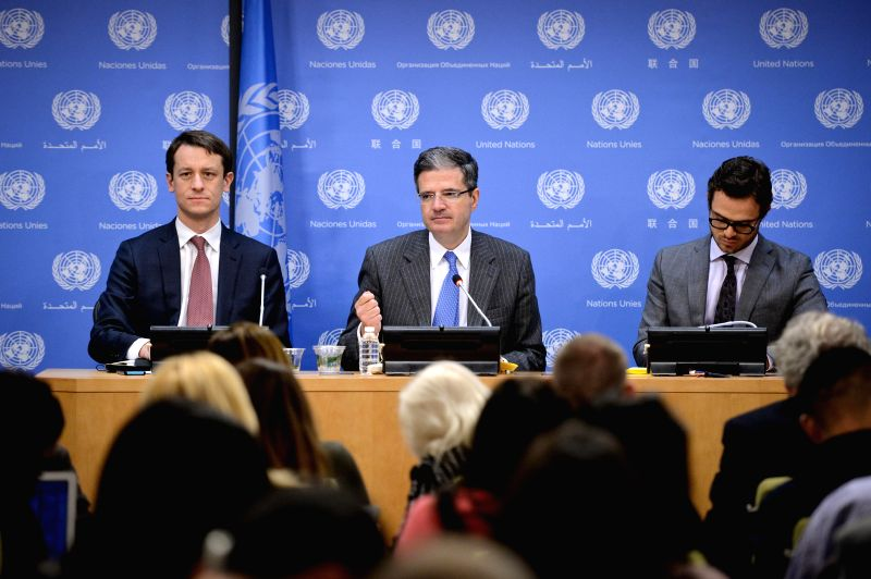 French Permanent Representative to the United Nations Francois Delattre (C), who is also president of the UN Security Council for the month of March, speaks during ...