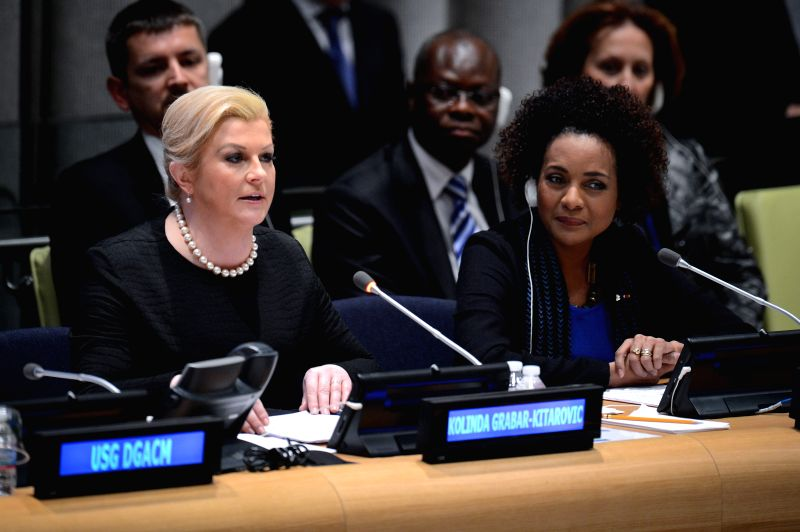 Croatian President Kolinda Grabar-Kitarovic (L) speaks as Michaelle Jean (R), General Secretary of the International Organization of the Francophonie, looks on ...