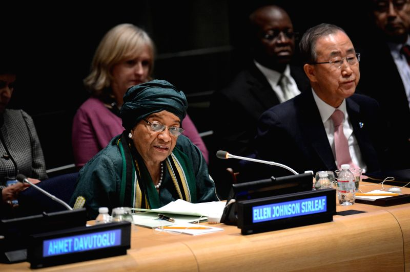 Liberian President Ellen Johnson Sirleaf (L) speaks as UN Secretary-General Ban Ki-moon looks on during a high-level debate on advancing gender equality, at the UN ...