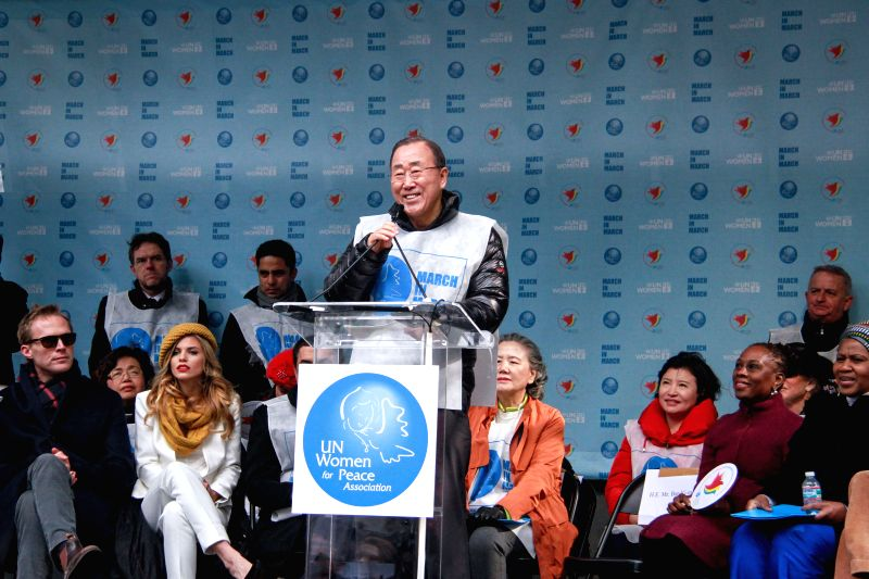 United Nations Secretary-General Ban Ki-moon (C) speaks prior to the start of the international Women's Day March for Gender Equality and Women's Rights, in New ...