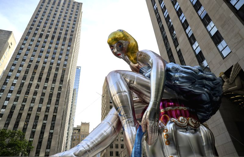 NEW YORK, May 12, 2017 - Photo taken on May 12, 2017 shows the Seated Ballerina at Rockefeller Center in New York, the United States. Seated Ballerina, the public art exhibition of a 45-foot tall ... - Jeff Koons