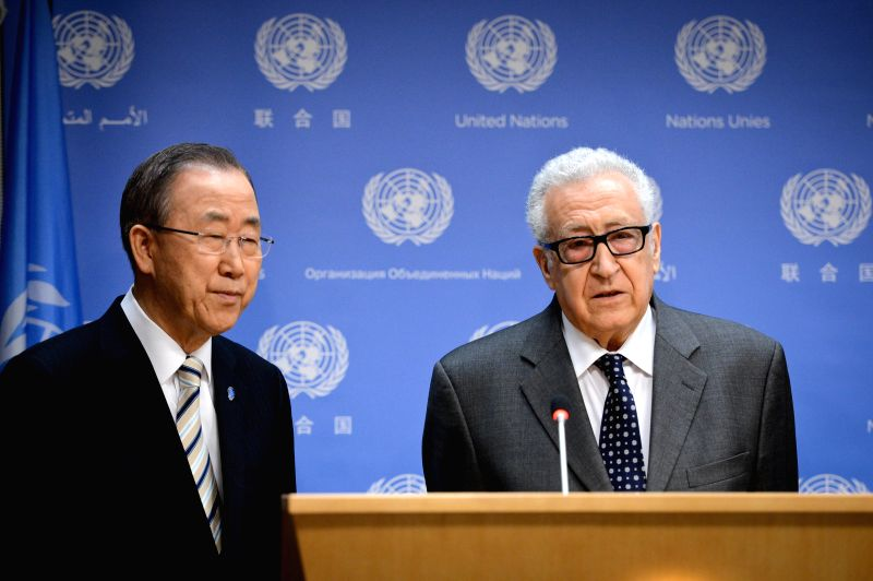 Lakhdar Brahimi (R), UN-Arab League special envoy to Syria, speaks as UN Secretary-General Ban Ki-moon looks on during a press briefing at the UN headquarters in ...